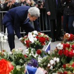 US Secretary of State John Kerry pays his respects at the makeshift memorial in Paris to the Charlie Hebdo victims.