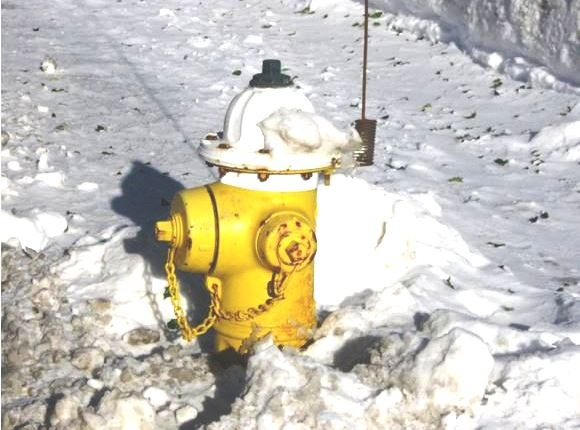 A fire hydrant already cleared on North Main St. in Essex.