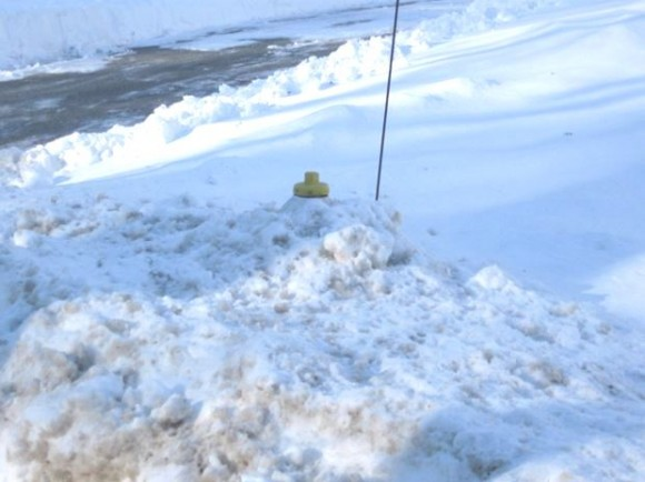 2)A snow-covered fire hydrant on Dennison Rd. in Essex, waiting to be cleared by residents.