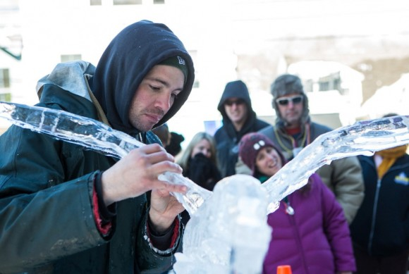Richard Daly works on his ice sculpture during the 2014 Winter Carnivale. Daly holds the Guinness Book of World Records for the fastest time to create ice sculptures. Photo by John Stack