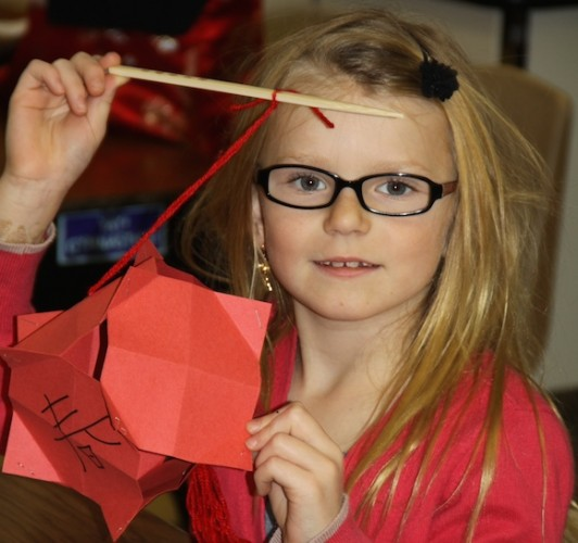 3rd Grader Raegan Wyrebek-Brasky makes a paper lantern during EESF's China Day.