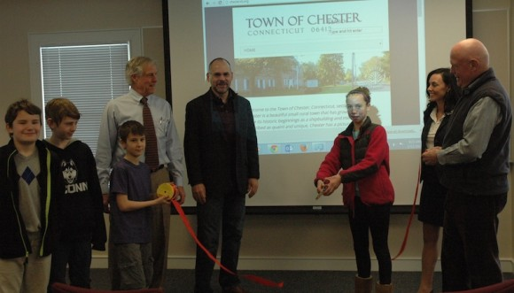 At the ribbon cutting ceremony for Chester Town Hall's new solar array were (from left to right): Michael Benjamin, Raen Corbett, James Tedeschi, First Selectman Ed Meehan, Chris Lenda from Aegis Solar, Leah Bargnesi, Maggie Treichel from CT Solar Challenge, and Pat Woomer from Chester Energy Team.