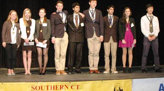 Andrew Pan (right) stands on the podium with the other winners at the Southern Connecticut Science and Engineering Fair.  Photo credit: www.scisef.org