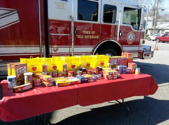 Food donations collected last year are gathered beside an Old Saybrook firetruck