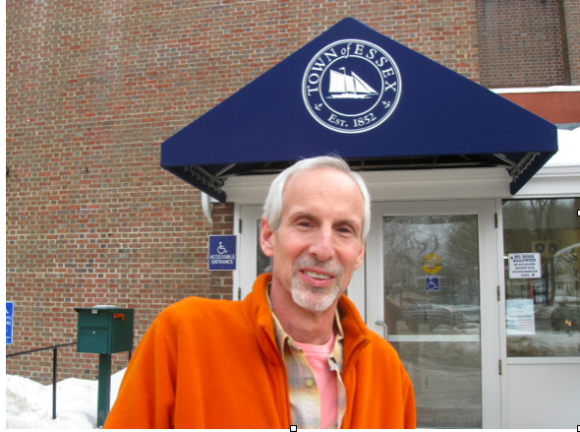 Essex First Selectman Norman Needleman stands beneath a new awning at the parking lot of Essex Town Hall