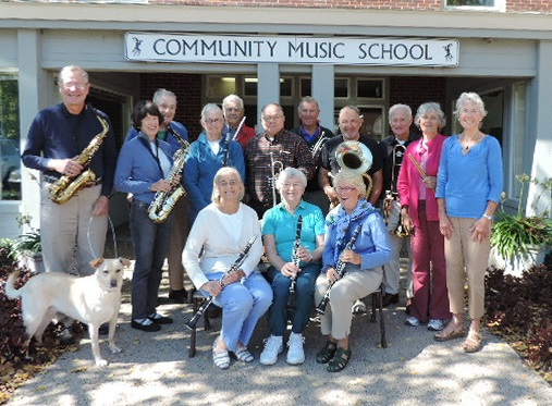 The New Horizons band of the Community Music School gather for a photo.