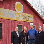 Essex Historical Society members Herb Clark, Susan Malan and Sherry Clark outside the Yellow Label Building with Rob Bradway of the Valley Railroad (second from right).