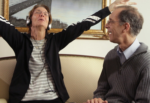 """An Alzheimer's patient reacts to music of """"The Beach Boys."""" Photo courtesy of BOND360"""