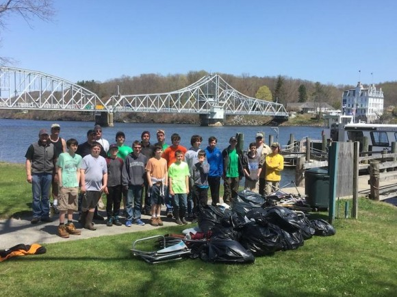 With the backdrop of the Goodspeed Opera House, the Old Saybrook Scouts gather for a photo to display the fruist of their labors after their trash pick-up efforts on Selden Island.