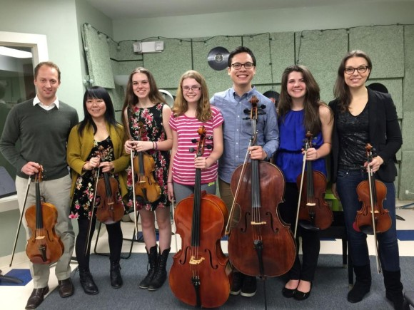 The Attacca Quartet and students from the Community Music School in Essex gathered after a string master class on Monday, April 20. Left-Right:   Luke Fleming, Keiko Tokunaga, Nadia PenkoffLidbeck, Noelle Avena, Andrew Yee, Bridget Haines, and Amy Schroeder.