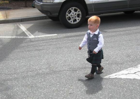 """This little boy's """"Mama"""" was playing in the band ahead of him in the parade."""
