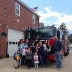 Members of the Westbrook Fire Department help collect food for the needy.