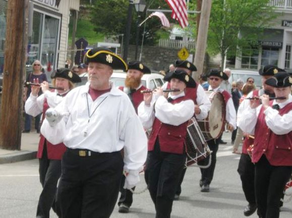 On and on the fife and drum corps came ...