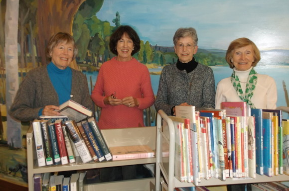 Preparing for the Sale are, from left to right, Debbie Barnes, Janice Atkeson, Linda Levene, and Ellie Champion