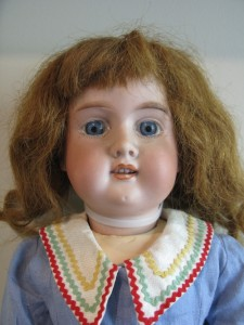 """Dolls, a dollhouse and a doll carriage are featured in the Chester """"Pastimes"""" exhibit as an example of playtime enjoyed by little girls for hundreds of years. This doll, owned by the Chester Historical Society, dates back to the early 1900s and has human hair."""