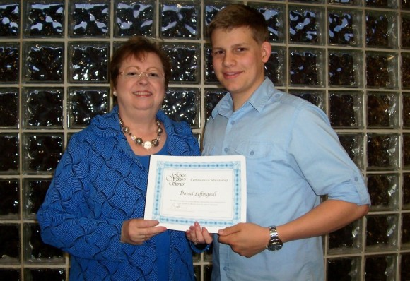 Louisa Ketron, a member of the Board of Trustees of Essex Winter Series, presented the Francis Bealey Memorial Scholarship to VRHS senior Daniel Leffingwell.
