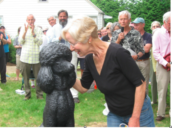 Morgana's sculpture receives an embrace from Ina Bomze.