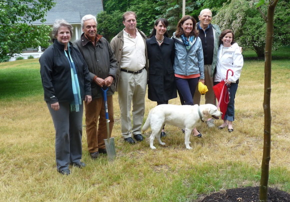 Pictured from left to right are Linda Newberg, President of the Essex Garden Club, Augie Pampel, club member and Essex Tree Warden with members of the Edwards family:  Kem Edwards, Debbi Lindstrom, Sarah Edwards Feeney, David Edwards, Mary Edwards Mather, and Lucy, the family yellow labrador.
