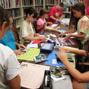 Leigh Basilone (center) will once again teach kids scrapbooking techniques at Chester Library this summer.