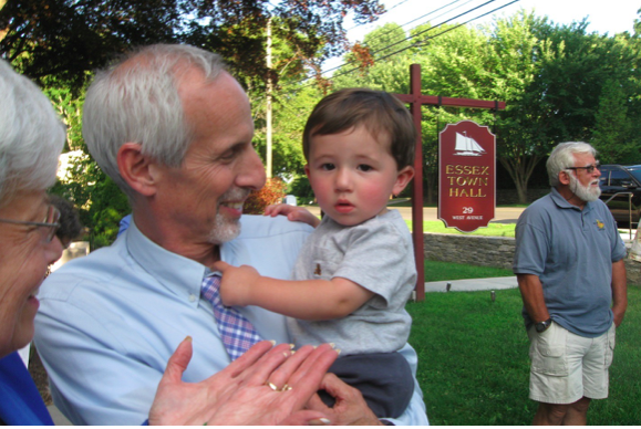 Essex First Selectman Norman Needleman holds his treasured grandson.