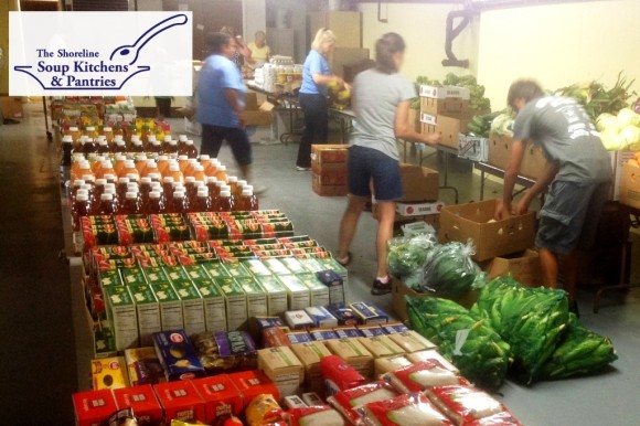 Volunteers set up for food distribution at the SSKP Old Saybrook pantry hosted by First Church of Christ in Saybrook.