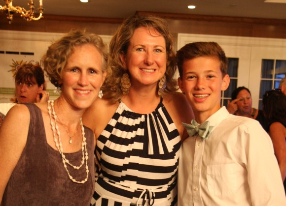 Joseph Coyne, the student leader on the fundraising project to construct a well in Uganda, with his mother Beth Coyne, Dean of Student Life at The Country School, and Martha Hoffman, founder of Call to Care Uganda.