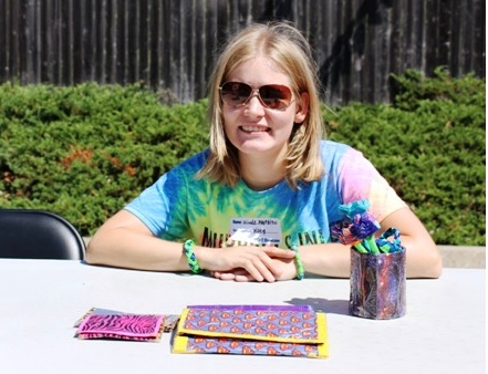 Vista member Nicole Martines proudly shows off some of her handmade duct tape accessories at the YASBIZ Showcase back in July, where she made her first-ever sale.