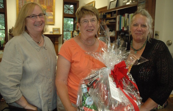 Basket winner and longtime Chester resident Pat Holloway, who was Chester's Library Director many years ago and recently retired as West Hartford's Library Director, is shown in the photo with Linda Fox, Chester Library Director (left), and Susan Wright, Chester Rotarian (right).