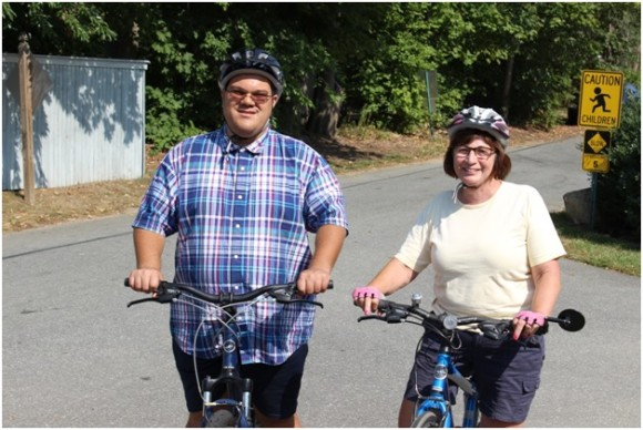 "Vista member David ""Curly"" Parish and his private tutor, Olive Moredock of Guilford, take their bikes for a spin around Curly's neighborhood in Clinton"