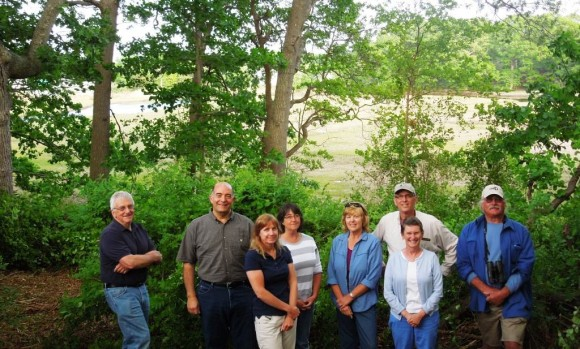 OSLT Board members on the Oyster River property after it's purchase was complete in 2014. L-R Bob Lorenz, Joe Nochera, Cathy Malin, Ann Gamble, Barb Guenther, Laurel Friedmann, Mike Urban and John Ogren.(photo by Jen Gamble)