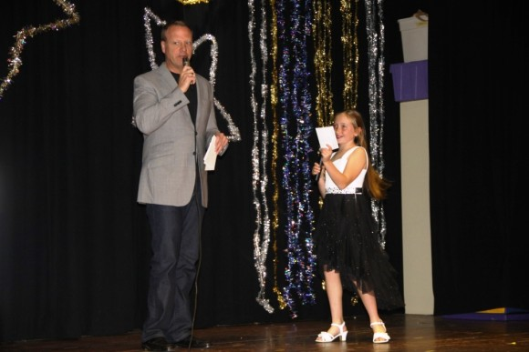 WFSB's Scot Haney and 5th grader Kendra Cika emcee the show