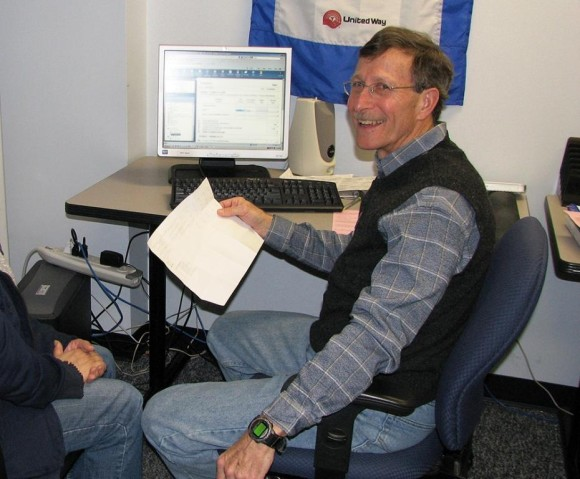 Volunteer Jay Keiser helps a client prepare their tax return at the Volunteer Income Tax Assistance site at the Middlesex United Way office