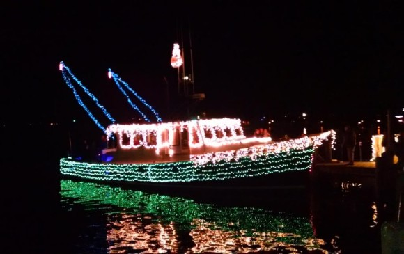 Boats in the annual Trees in the Rigging Lighted Boat Parade are decorated with holiday lights.