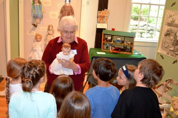 "At the Chester Museum at The Mill, listen to Peg Lieberman's tales about sledding down the streets of Chester right to Jennings Pond and check out her childhood doll in the ""Pastimes"" exhibit."