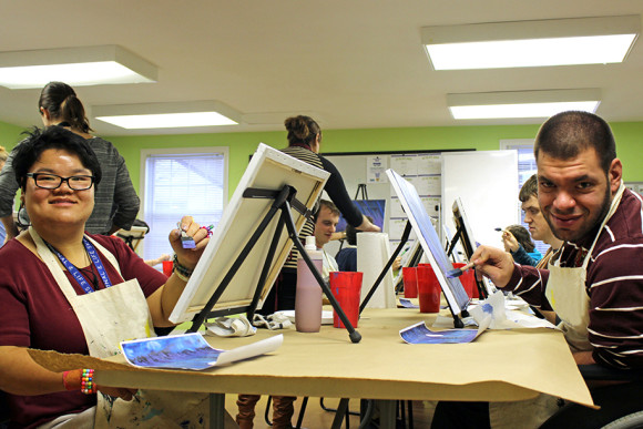 Day Program members Yan Qin Keller and Josh Buglione participate in a painting activity. Photo by Vanessa Pereira.