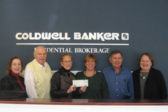 The Coldwell Banker Residential Brokerage Essex office recently presented an $800 donation to the Essex Housing Authority. Pictured from left are affiliated sales associates Dee Hasuly, Roy Monte, Laurel Peters, Tammy Mesite of the Essex Housing Authority, Peter Bonanno, and Jeanne Rutigliano, manager of the Coldwell Banker Essex office.