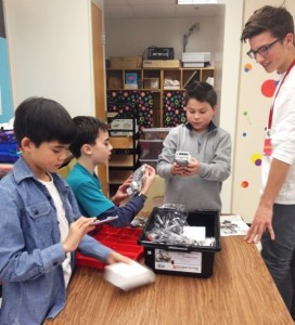 Fourth graders - Devon Welch, Noah Santangelo and Ben Rector - work with Luke DeFrino of Chester, a junior at Valley Regional High School, during a new LEGO robotics program at EES.
