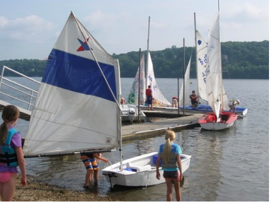 Pettipaug Sailing Academy sailors putting their boats in the water in a recent sailing season