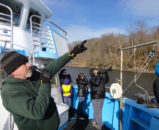Connecticut River Museum environmental educator Bill Yule leads the boat tours and helps participants spot Bald Eagles, wintering hawks and waterfowl and other wildlife from the deck of EnviroLab III. Photo: Connecticut River Museum