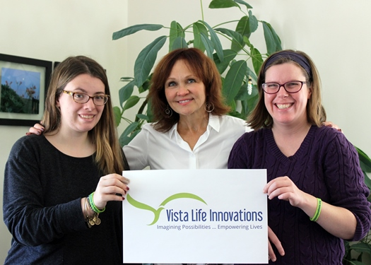 Vista student Julia Kane, Chief Executive Officer Helen Bosch and member Rachael Hoskin (L-R) proudly show off the new organizational logo. Photo: Vanessa Pereira