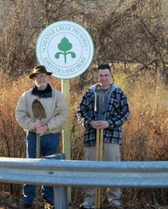 Richard Harrall, Chester Land Trust president (left) and Bill Meyers, Trustee, installed new Land Trust signs. Photo by Vivian Beyda