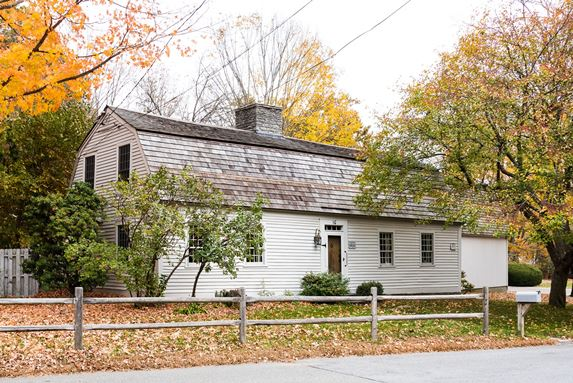 Known locally at the Dunk House, this antique Cape Cod-style home is priced at $595,000.