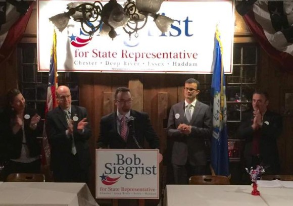 Flanked by Devin Carney (R-24th) to his left and Senator Art Linares (R- 33rd) to his right, Bob Siegrist announces his intention to run for the 30th District seat in November.