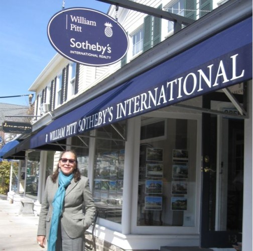 Award-winning Essex realtor Colette Harron stands outside the Sotheby's International office on Main Street in Essex.
