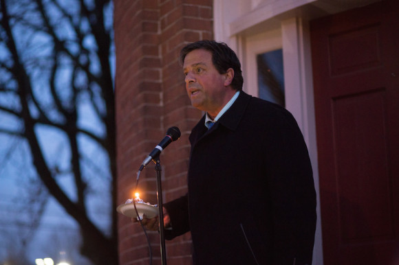State Senator Phil Miller addresses the vigil participants.