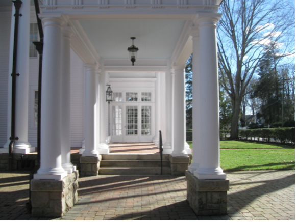 The Dickinson Mansion has an attractive side entrance with distinctive columns.