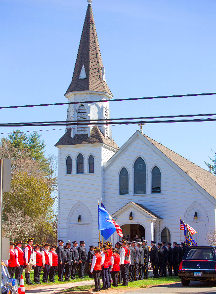 "Representatives of various organizations, including the police and Deep River Fife & Drum Corps., stand somberly outside Chester RC Church prior to the funeral service for Richard ""Smitty"" Smith. Photo by Kim Tyler."