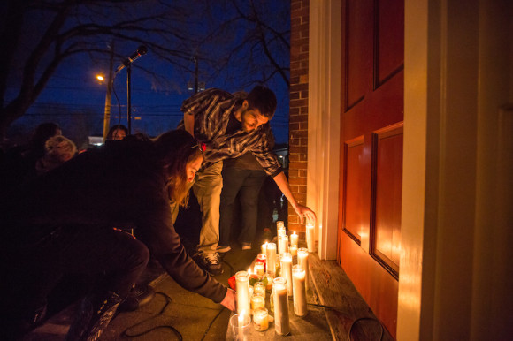 """Candles are lit in honor of """" a remarkable legacy to service, commitment, and dedication to the people of Deep River."""" Photo by Kim Tyler."""
