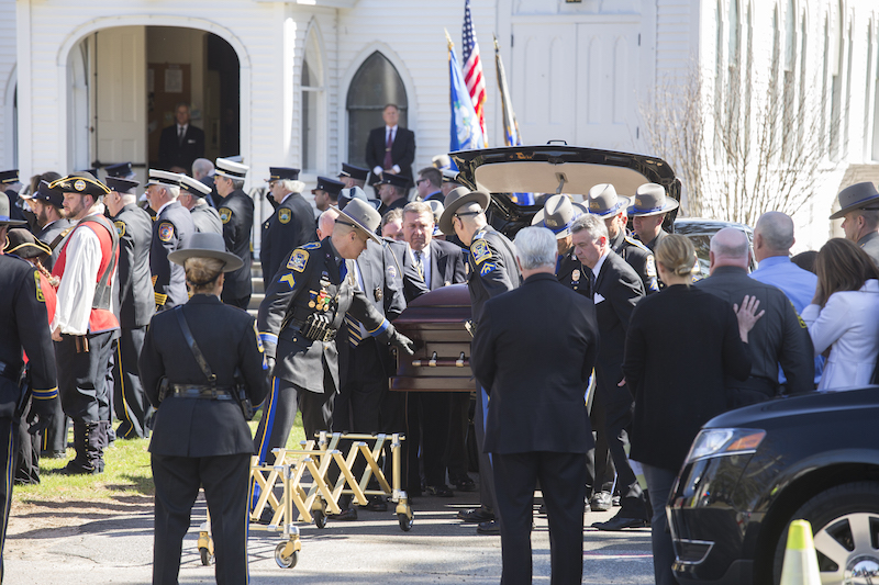 The sad task of removing the coffin from the hearse.  Photo by Kim Tyler.