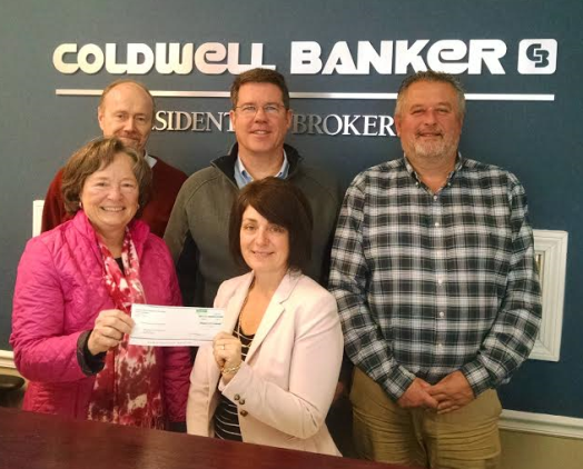 The Coldwell Banker Residential Brokerage Essex office recently presented a $1,000 donation to the Essex Department of Social Services. Pictured from left are Marguerite Mattison, a Coldwell Banker sales associate; Mary Ellen Barnes of the Essex Department of Social Services; and Rick Greene, Peter DePatie and Joel Lucas, all Coldwell Banker sales associates.